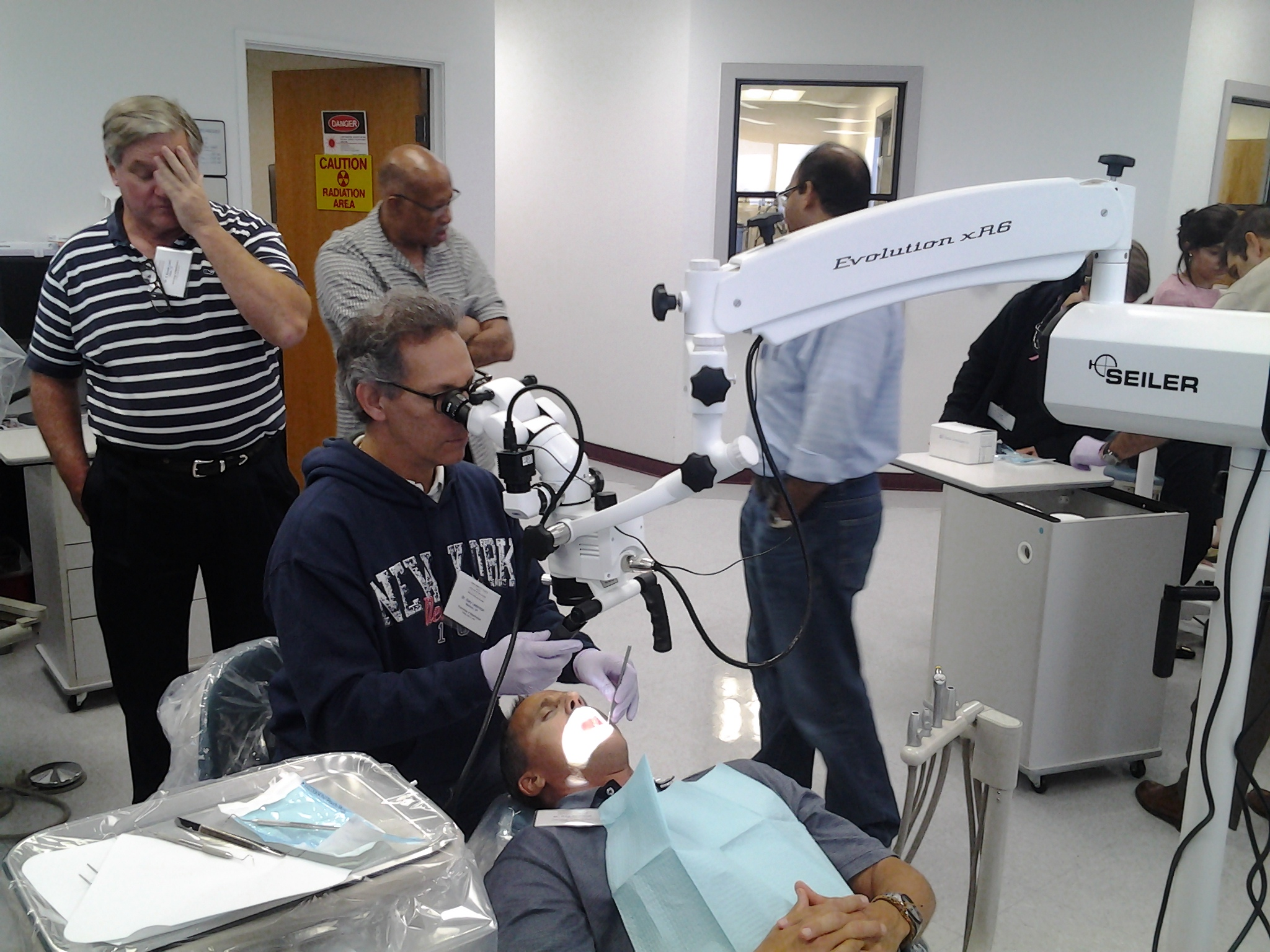 Dentist using scope on patient